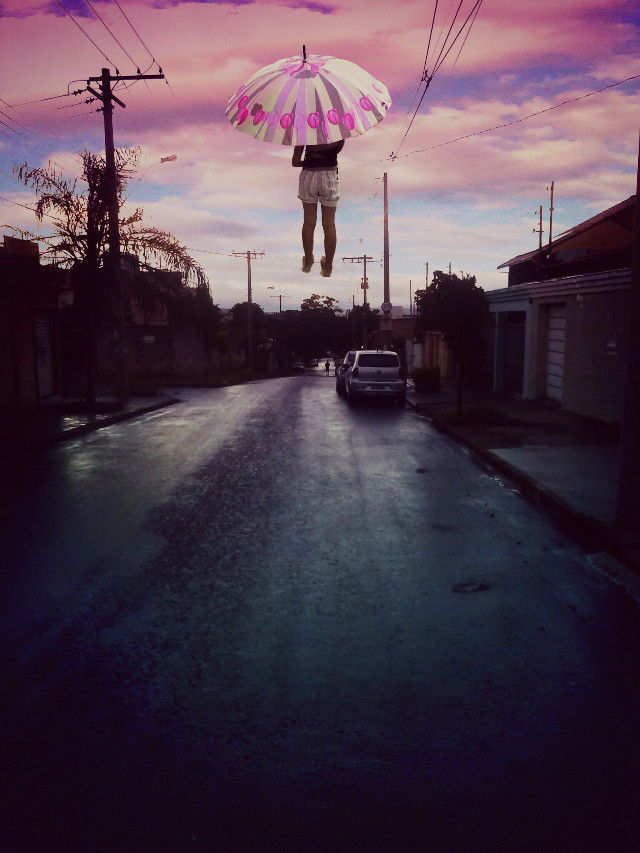 extraordinary events occur in my street, this time a girl levitated the sky with an umbrella #levitate #umbrella #sky #pink #blue