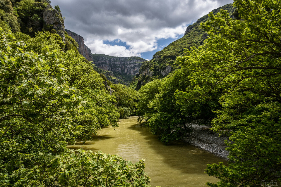 The gorgeous Voidomatis River with the famous Vikos Canyon in the background. Vikos Canyon is situated in the Epirus Mountains, Greece, near the border to Albania. It is 900m deep and only 1200m wide. In 1997 it had its entry in the Guinness book of records for being the deepest Canyon of the world. Though Grand Canyon is actually much deeper, Vikos Canyon is much narrower. So it is actually the relation of width and depth that made it being selected for being the deepest Canyon of the world...    #travel #photography #nature #epirus #greece #river  #voidomatis #fairyland
