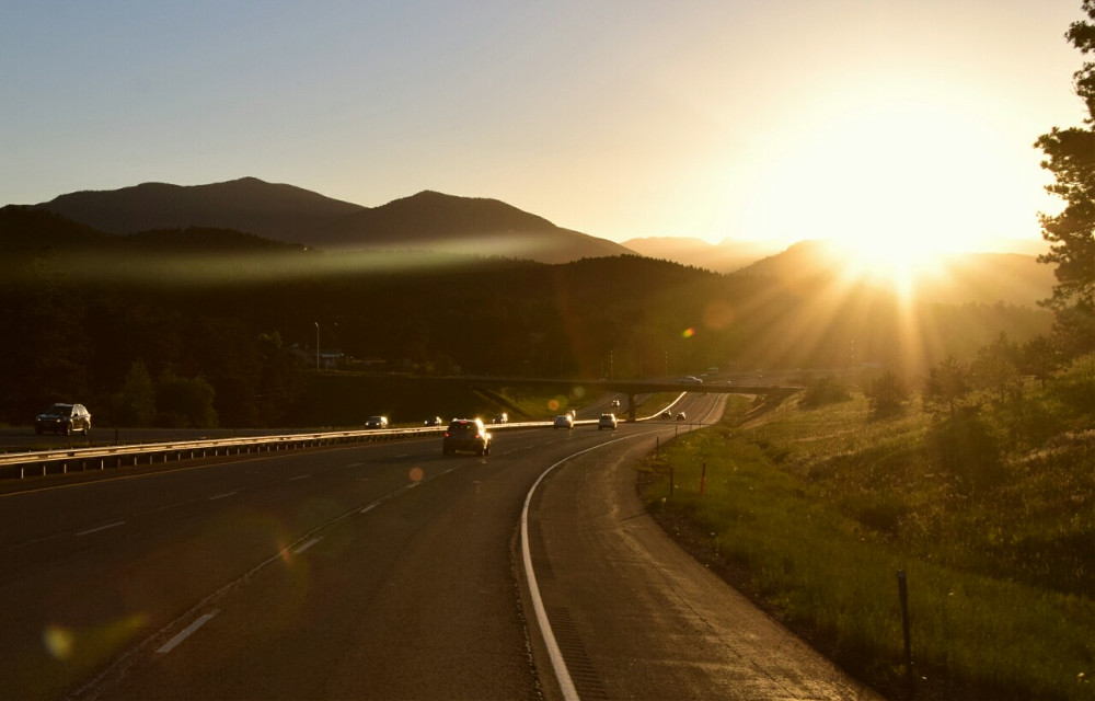 Mindshift Day 196  When the sun is shining I can do anything; no mountain is too high, no trouble too difficult to overcome. -Wilma Rudolph  #mindshift #day196 #sunset #road #shadows #dark #sun #flare #Colorado